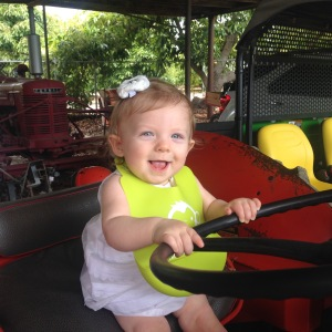 The flower girl loved driving the tractor.